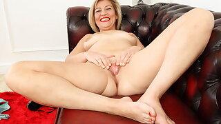 British milf Filthy Emma rubs her fanny on sofa