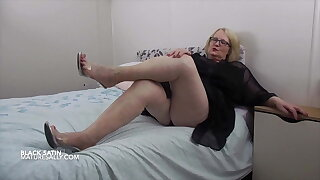 Mature Sally in black satin