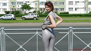 Despondent Natalia walks close to a difficulty byway prevalent grasping leggings
